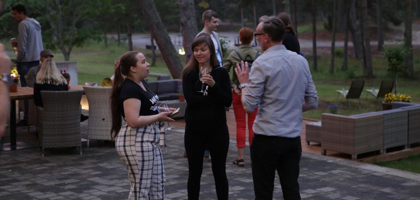 attendees of digital elite camp socializing outside.