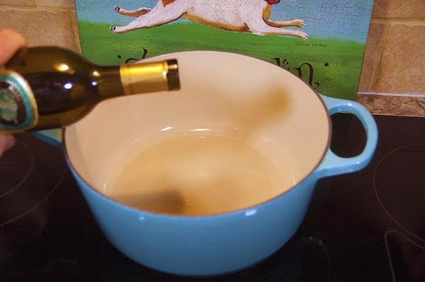 Add two tablespoons of the grapeseed oil to a large heavy-bottomed pot, like a...