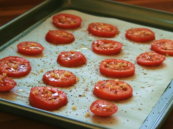 For the Oven-Roasted Tomatoes: Preheat oven to 275 degrees. Slice tomatoes into 16 slices (8...