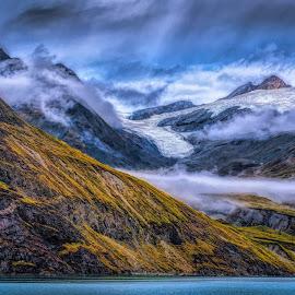 Mountainscape by Garry Dosa - Landscapes Mountains & Hills ( sky, mountains, supernatural, clouds, water, mist, orange, blue, outdoors, vista, landscape, fog, colours,  )