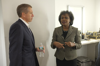 Photo: POY panelists Brian Williams and Anita Hill. Photo by: Jemal Countess/Getty