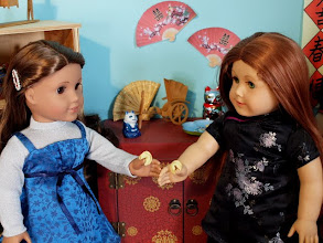 Photo: Mari and Libby crack open their fortune cookies.