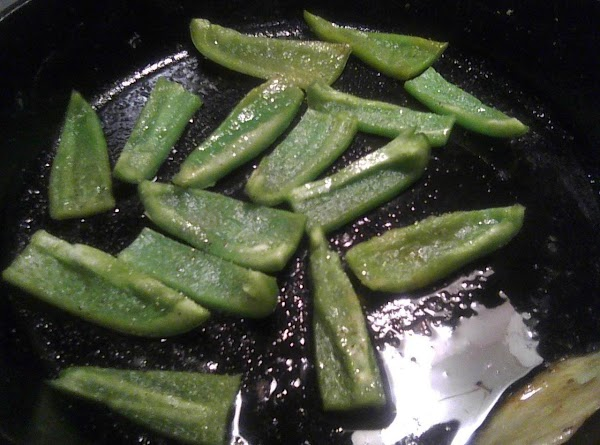 Take about 2 green peppers.  Cut off tops and seeds.  Slice the...