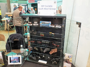 Photo: 005 The SWOONS display cabinet that started as a cheap purchase from a 2nd hand furniture shop and was turned into a very professional looking display by the members. Note also the 009 Society publicity leaflets and the digital tablet showing a slide show of narrow gauge model photos. Quite a simple display but very effective .