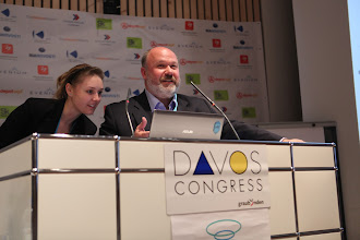 """Photo: Ekaterina Lavrova helping with pc screen - Sergey Zverev speaking - panel on """"Latest ternds for Comms Consultancies"""" - 2012"""