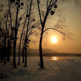 Sunset over the frozen lake by Sona Gerekova - Landscapes Sunsets & Sunrises ( winter, sunset, snow, landscape, frozen )