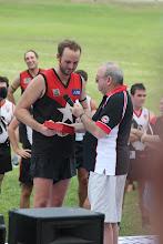 Photo: Johno presents the BOG Trophy to Tom Harvey. Photo, Anne-Marie Robb.