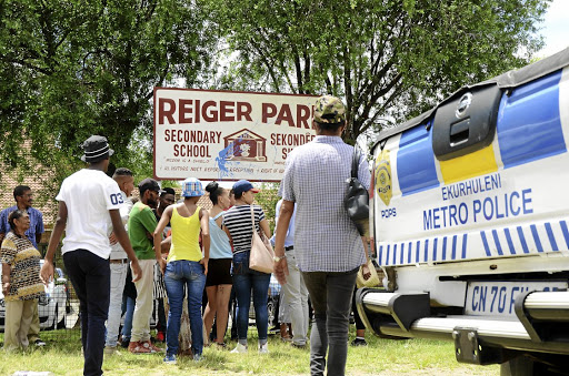 Angry Reiger Park community members gathered outside the local school yesterday, demanding that a 'sex-pest' principal be prosecuted.