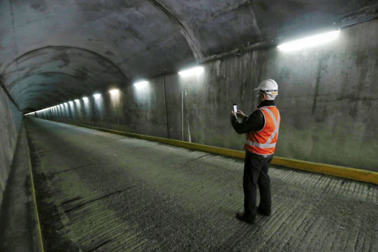 Australian Prime Minister Malcolm Turnbull takes a photo of the tunnel with his phone during a tour of the Snowy Hydro Tumut 2 power station in Cooma, Australia August 28, 2017.