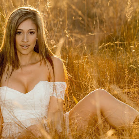 by DM Photograpic - People Portraits of Women ( grass, sunset, boots, model )