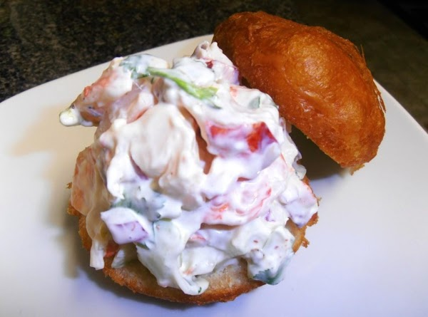 slice the biscuits in half.  add lobster and shrimp salad.  ENJOY!