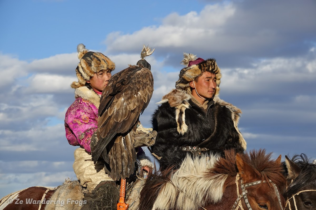 Mongolia. Golden Eagle Festival Olgii. Two of the young participants, including an 11-year old girl
