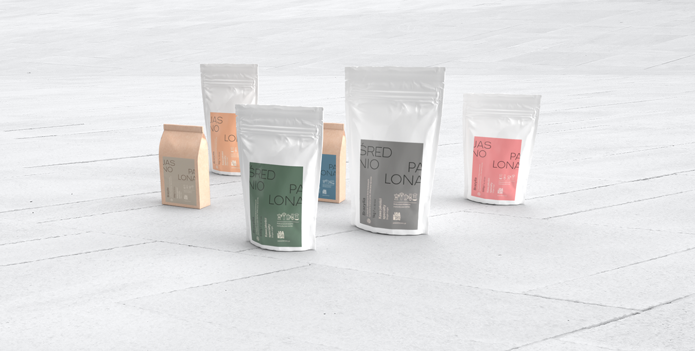 Several standing packs of coffee on white concrete tiles.
