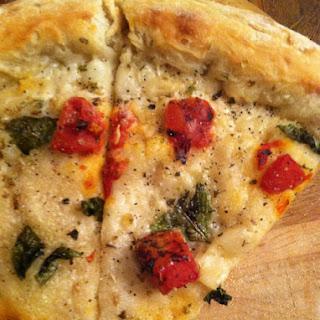 Vegan White Pizza w/ Roasted Tomatoes & Basil.