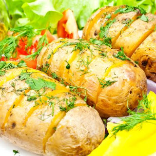 Golden Baked Potatoes With Herb Butter