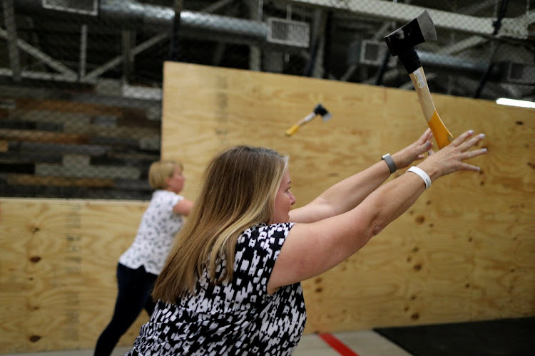Axe throwing is a sport that started in the Canadian backwoods and is growing in popularity in US cities such as LA.
