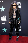 H.E.R. poses in the press room at the 2019 BET Awards.