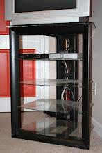 Photo: $755-shelf TV stand w/ glass shelves