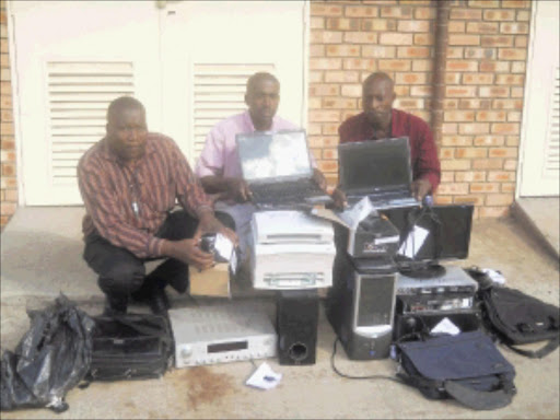 HARD WORK: Tonga police spokesperson Sergeant Mzwandile Nyambi, detective constables Dumisani Zwane and Lucky Mhlanga display stolen goods recovered in Mgobodzi in Mpumalanga yesterday. Pic: MASOKA DUBE. 18/05/2010. ©Sowetan.