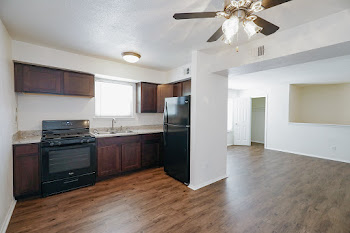 Renovated three bedroom floorplan with a fully-equipped kitchen and wood-style flooring