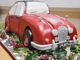 Jaguar car shaped wedding cake