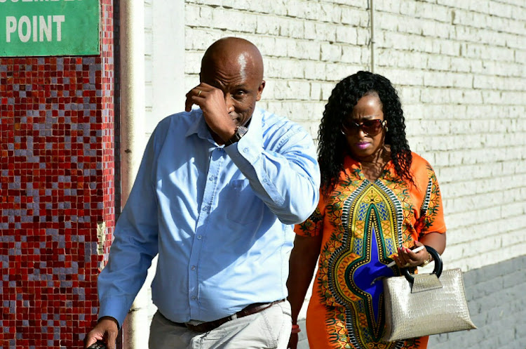 Phillip Masiza and his wife Tiny hand themselves over to The Hawks