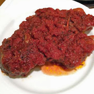Oven-Braised Beef with Tomatoes and Garlic.