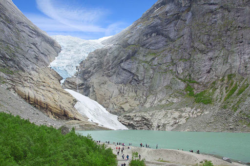 Norway-Briksdalsbreen2 - Visitors to Jostedalsbreen National Park walk from the glacial lake to the Jostedalsbreen north of Bergen, Norway.