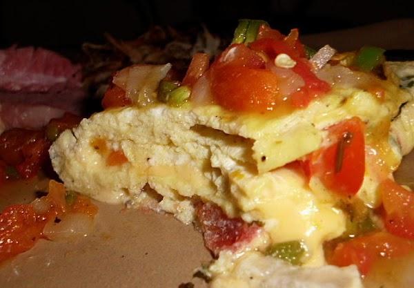 Break 3 eggs into a small bowl and add 2 tablespoons of pico de...