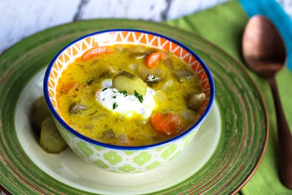 Polish Pickle Soup In A Bowl With Sour Cream On Top.