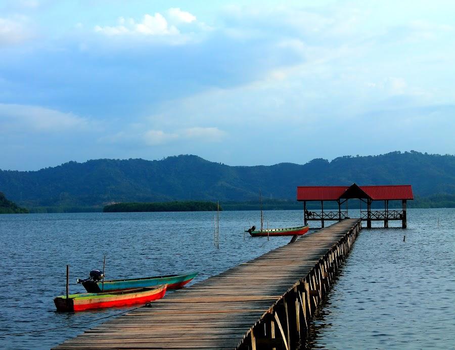 Peaceful Scene At Tuaran by Rusli Amir - Transportation Boats ( nature, sea village, wood bridge, sea, bridge, waterscapes, boat )