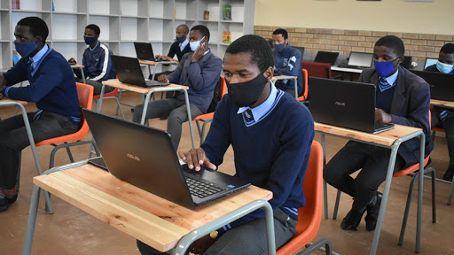 Learners at the OR Tambo Technical High School sit in front of laptops in the school's cyber lab. (Photo source: Twitter)