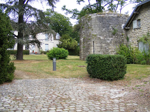 Photo: Across the street is the Departmental Tourism Office, which I am peeking at through a locked gate. The old stone tower at center right is some of what little remains of the original 13th century château de la Motte, also called the château d'En Bas (basically, the Lower Castle)