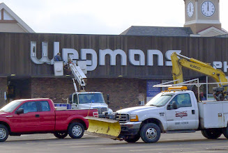 Photo: Taking down the old sign, with its cool old logo.