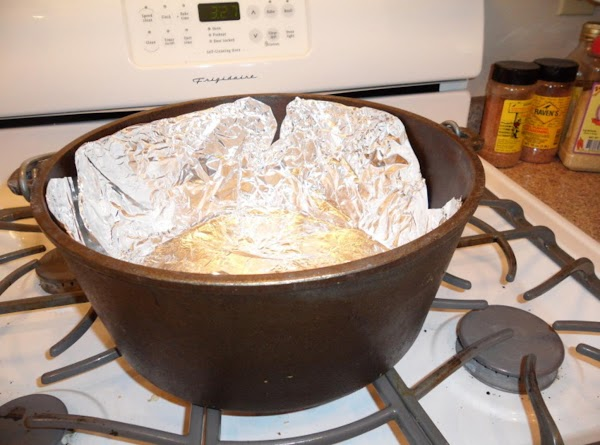 For easy clean-up, line dutch over with foil. Be sure that all edges are...