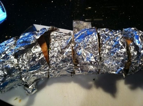 REMOVE FROM OVEN & WITH A SERRATED KNIFE CUT INTO SLICES THRU FOIL (THIS...
