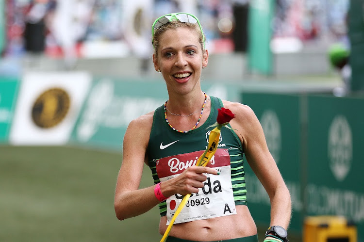 Marathon runner Gerda Steyn triumphed in wet conditions in Italy.