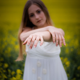 In the picture by Vix Paine - Babies & Children Child Portraits ( hands, beauty, dancers, pose, rapeseed field, dance photography, child dancer, dance move, yellow, ballet, sisters, bare feet, teenagers, flower, dancer, working together, colour, rapeseed, family, sister, child, teenager )