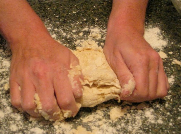 On a lightly floured surface, knead dough for about 3 to 4 minutes.