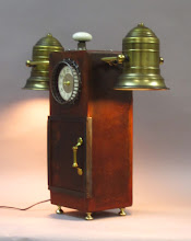 Photo: lamp and clock - steel and brass