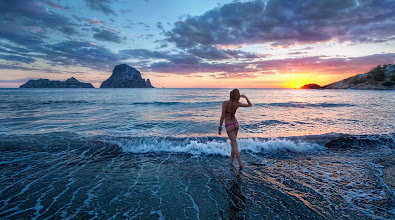 """Photo: Sunset in Ibiza   Ibiza is a fabulous island off the coast of Spain that is the """"in"""" destination for all the Euros that like to get trashed, party, dress in white, do medium-level-drugs, and stay on the beach without many clothes.  I saw this girl bouncing around and very happy about something, so I went over and said hello, introducing myself. She didn't speak much English, but I managed to ask her if I could take a photo of her. She enthusiastically said yes, and I explained the sitch as we walked over to the water, mostly using interpretive dance to span the language gap. She was Italian and her name was Wendy. I think that is a strange name for an Italian, but I didn't question it. Anyway, I asked her just to walk off into the ocean and I would take a photo. She did just that, and I grabbed this shot just as the sun was dipping below the horizon.  from Trey Ratcliff at www.stuckincustoms.com"""