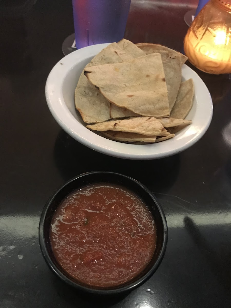 They brought out grilled tortilla chips with my own salsa