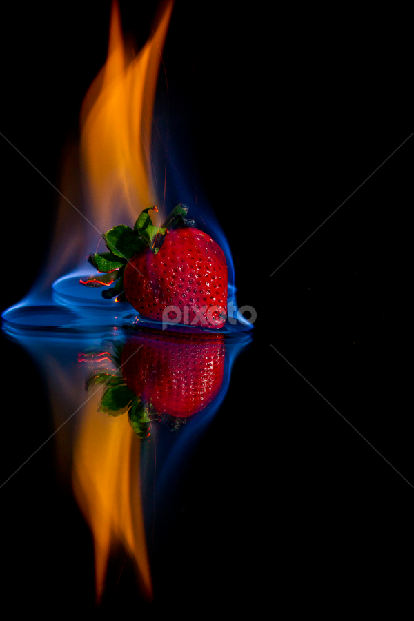 Strawberry flame by SumPics Photography - Food & Drink Fruits & Vegetables ( orange, reflection, warm, leaf, strawberry, fire, flame, black background, red, blue, stem, black, flambe )
