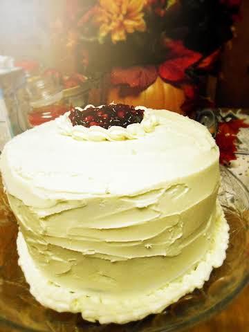 Cranberry Eggnog  Cake with Orange Buttercream