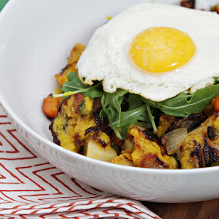 Root Vegetable Hash Browns With Fresh Turmeric Sauce And Fried Eggs.