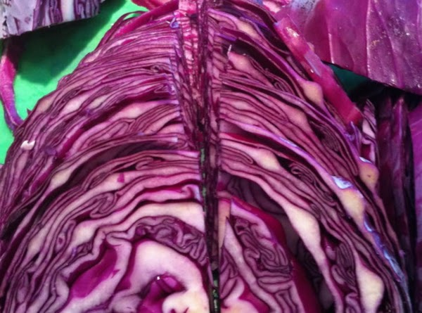 Core and slice into four pieces. Slice into 1/8 thick pieces. Slice red onion...