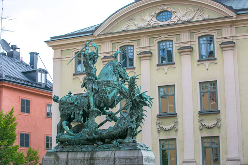 St.-George-and-dragon-statue.jpg -  A bronze sculpture of Saint George and the Dragon, dating to 1912,  is located in Merchant Square in Gamla Stan, the oldest area of Stockholm.