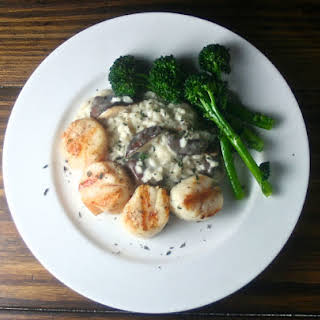 Grilled Sea Scallops with Wild Mushroom Risotto and Grilled Broccolini.