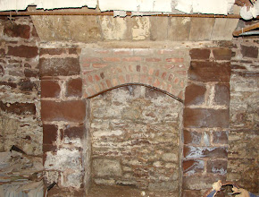 Photo: One of the brown sandstone fireplaces in the basement. April, 2012.