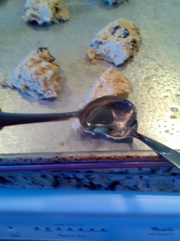 Preheat oven 350 Degrees.  Drop cookie dough from spoon on cookie sheet. ...